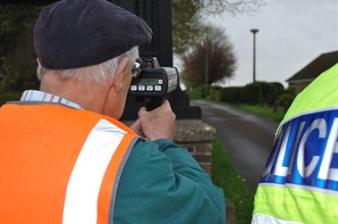 A police traffic officer assists a volunteer during the recent pilot scheme
